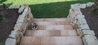 19_nachher_rollrasen_bepflanzung_natursteinmauer_treppe