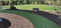 27_nachher_rollrasen_bepflanzung_natursteinmauer_treppe
